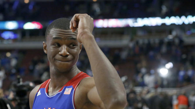 Kansas guard Andrew Wiggins acknowledges the crowd after Kansas beat Duke 94-83 after an NCAA college basketball game Tuesday, Nov. 12, 2013, in Chicago. Kansas won 94-83. (AP Photo/Charles Rex Arbogast)
