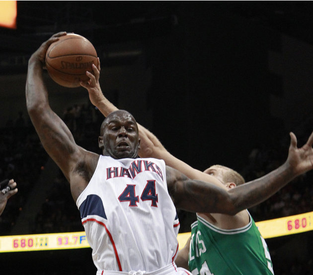 Atlanta Hawks forward Ivan Johnson (44) and Boston Celtics center Greg Stiemsma (54) vie for a rebound in the first half of Game 2 of an NBA basketball first-round playoff series Tuesday, May 1, 2012,