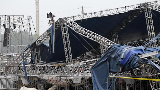 FILE - In this Aug. 14, 2011 file photo, Indiana State Police and authorities survey the collapsed rigging and Sugarland stage on the infield at the Indiana State Fair in Indianapolis. The stage collapse before a Sugarland concert was a late wake-up call for people who manage large public venues like concert grounds and football stadiums. Venue managers gathered in Norman, Okla., Tuesday and Wednesday, March 5-6, with weather forecasters and revealed there have been many close calls. (AP Photo/Darron Cummings, File)