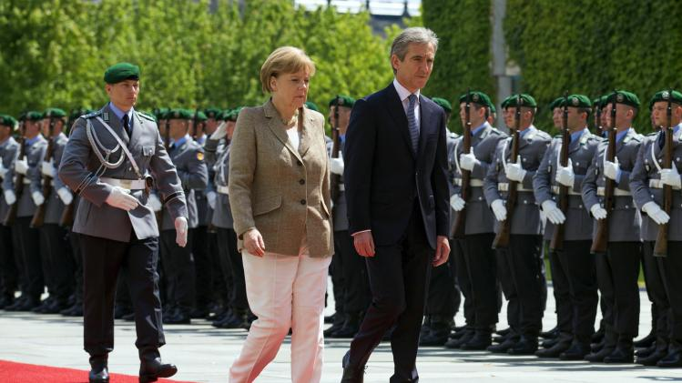 German Chancellor Merkel and Moldova's Prime Minister Leanca review honour guard before talks at Chancellery in Berlin