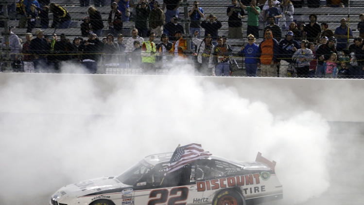 Brad Keselowski (22) does a burnout as he celebrates after winning the NASCAR Nationwide auto race at Richmond International Raceway in Richmond, Va., Friday April 26, 2013. (AP Photo/Steve Helber)