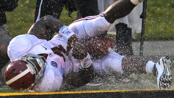 Alabama running back T.J. Yeldon causes a splash as he lands in the end zone at the end of a 15-yard touchdown run during the second quarter of an NCAA college football game against Missouri Saturday, Oct. 13, 2012, in Columbia, Mo. (AP Photo/L.G. Patterson)