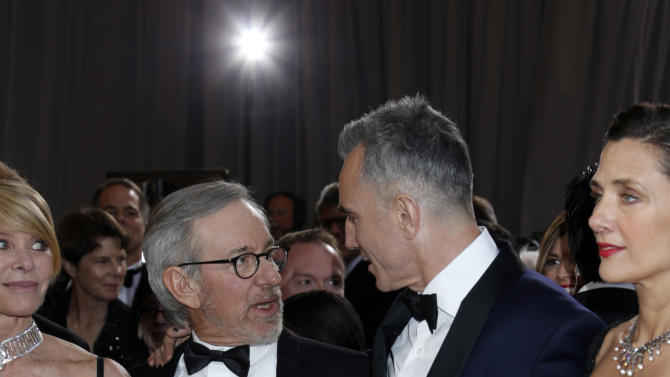 Kate Capshaw, Steven Spielberg, Daniel Day-Lewis and Rebecca Miller arrive at the Oscars at the Dolby Theatre on Sunday Feb. 24, 2013, in Los Angeles. (Photo by Todd Williamson/Invision/AP)