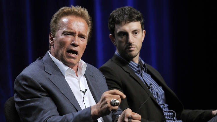 "Former California Gov. Arnold Schwarzenegger, left, the subject of a forthcoming ESPN short film, answers a question as the film's co-director Michael Zimbalist looks on during the ESPN Films ""30 for 30 Shorts"" TCA panel discussion at the Beverly Hilton hotel on Friday, Aug. 3, 2012 in Beverly Hills, Calif. The film will focus on Schwarzenegger's teenage years in the Austrian army. (Photo by Chris Pizzello/Invision/AP)"