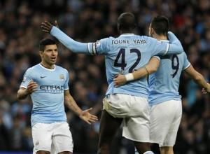 Manchester City's Sergio Aguero celebrates his second goal during their English Premier League soccer match against Tottenham Hotspur at the Etihad Stadium in Manchester