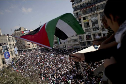 A girl waves a Palestinian flag during a rally in support of the Palestinian bid for statehood recognition in the United Nations, in the West Bank city of Ramallah, Wednesday, Sept. 21, 2011. Thousands of flag-waving Palestinians rallied Wednesday in towns across the West Bank to show support for their president's bid to win U.N. recognition of a Palestinian state. (AP Photo/Tara Todras-Whitehill)
