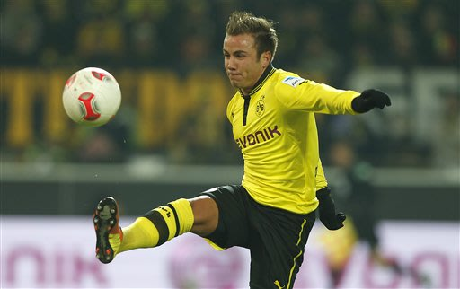 In this Jan. 25, 2013 file photo Dortmund's Mario Goetze challenges for the ball during the German first division Bundesliga soccer match between  BvB Borussia Dortmund  and 1.FC Nuremberg in Dortmund