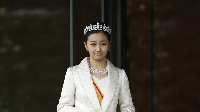 Japan's Princess Kako, the second daughter of Prince Akishino and Princess Kiko, in full dress leaves the Imperial Palace after a meeting with the emperor and empress  in Tokyo