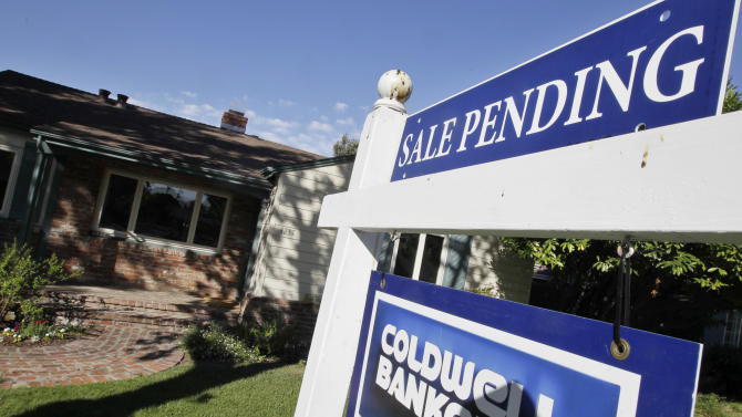 FILE-This Tuesday, Aug. 21, 2012, photo, shows an exterior view of house with a pending home sale sign in Palo Alto, Calif. The number of Americans who signed contracts to buy previously occupied homes fell in August from a two-year high in July. The National Association of Realtors says its index of sales agreements dropped 2.6 percent last month to 99.2. In July, the index rose to 101.9. That was the highest level since April 2010, when the market benefited from a federal home-buying tax credit. (AP Photo/Paul Sakuma, File)