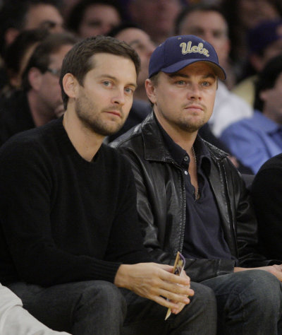 FILE - In this Dec. 22, 2009, file photo, actors Tobey Maguire, left, and Leonardo DiCaprio watch an NBA basketball game between Los Angeles Lakers and the Oklahoma City Thunder in Los Angeles. DiCaprio and Maguire lead a cast of stars in a new public service announcement urging young voters to use social media to express the issues most important to them in the upcoming election.(AP Photo/Jae C. Hong, File)