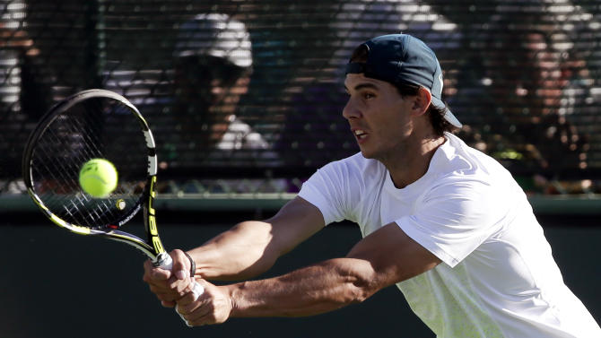 Rafael Nadal, of Spain, practices before the the BNP Paribas Open tennis tournament in Indian Wells, Calif. Wednesday, March 6, 2013. (AP Photo/Chris Carlson)