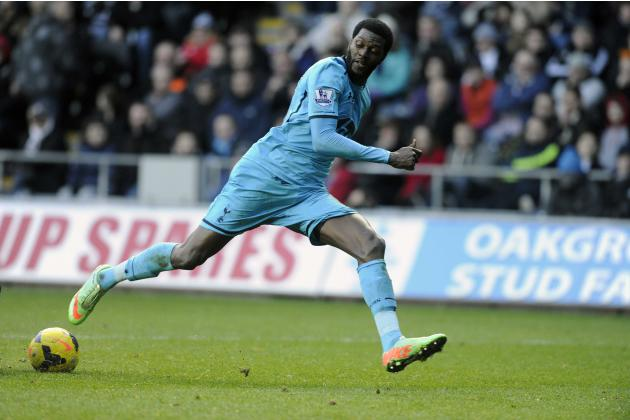 Tottenham Hotspur's Adebayor in action during their English Premier League match against Swansea City at the Liberty Stadium in Swansea