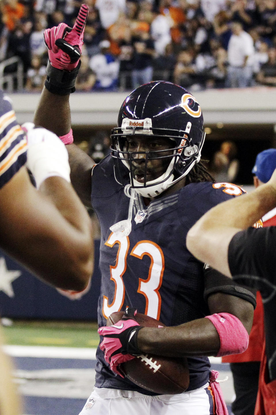Chicago Bears cornerback Charles Tillman celebrates after returning an interception for a touchdown during the first half of an NFL football game against the Dallas Cowboys, Monday, Oct. 1, 2012, in Arlington, Texas. (AP Photo/Tony Gutierrez)