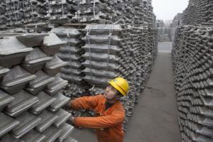 File photo of an employee checking aluminium ingots for export at Qingdao Port