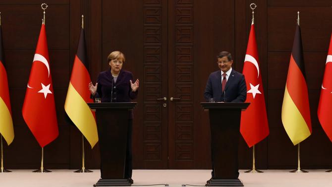 German Chancellor Merkel gestures during a joint news conference with Turkish Prime Minister Davutoglu in Ankara