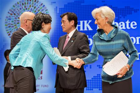 "Head of the International Monetary Fund (R) Christine Lagarde shakes hands with moderator NHK anchor Kaori Iida next to Japan's Finance Minister Koriki Jojima (2nd R) and Klaus Schwab, founder and executive chairman of the World Economic Forum, during the ""Globalization at a Crossroads: From Tokyo to Tokyo"" debate at the Tokyo International Forum October 11, 2012. REUTERS/Stephen Jaffe/IMF/Handout"