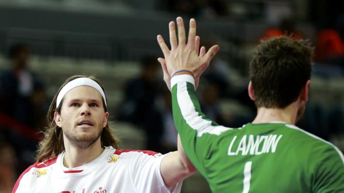 Hansen of Denmark celebrates a goal against Spain with goalkeeper Landin during their quarterfinal match of the 24th Men's Handball World Championship in Doha