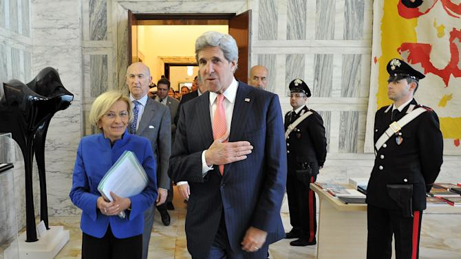 Italian Foreign Minister Emma Bonino, left, and US Secretary of State John Kerry walk together prior to an official meeting in the Foreign Ministry building in Rome on Thursday May 9, 2013.  (AP Photo/Mladen Antonov, Pool)