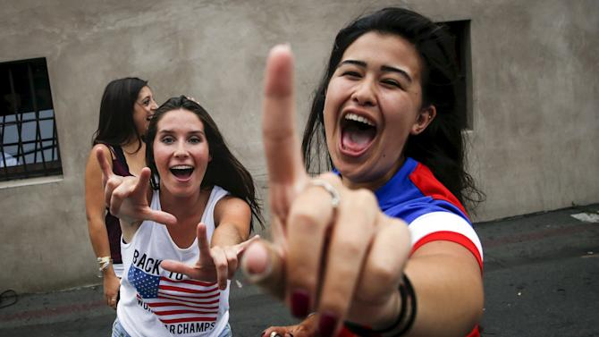 U.S. fans celebrate USA's win in the Women's World Cup final soccer match against Japan, in Hermosa Beach, California