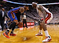 Carmelo Anthony (L) of the New York Knicks and Miami Heat's LeBron James during game two of the NBA Eastern Conference first-round playoff series on April 30. James scored 19 to power Miami over New York 104-94