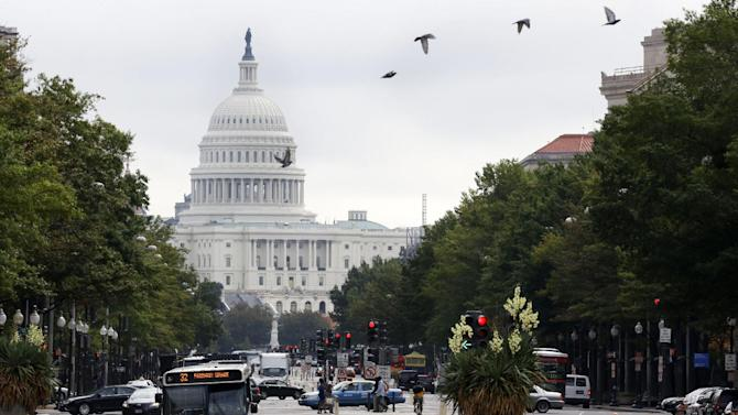 """Birds fly across Pennsylvania Avenue NW with the Capitol in the background in Washington, Wednesday, Oct. 3, 2012. Pennsylvania Avenue, sometimes called """"America's Main Street,"""" is being listed among the nation's endangered landscapes because of neglect and deferred maintenance by the National Park Service. The nonprofit Cultural Landscape Foundation told The Associated Press on Wednesday that the grand avenue connecting the Capitol and White House is slowly falling into disrepair. Water fountains are left rarely functioning, benches are broken and some trees have been removed.  (AP Photo/Jacquelyn Martin)"""