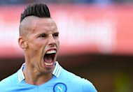 Napoli's midfielder Marek Hamsik of Slovakia celebrates after scoring against Chievo on August 31, 2013 in Verona
