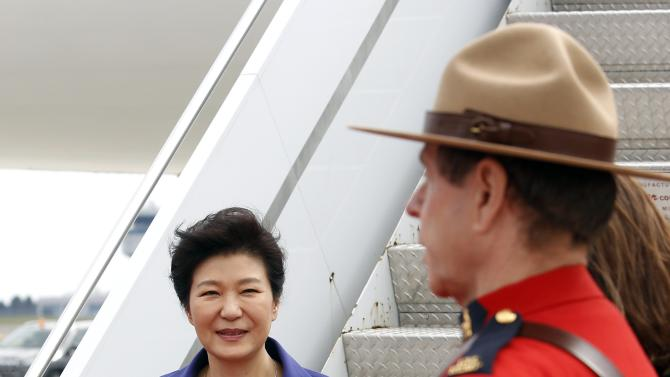 South Korea's President Park Geun-hye disembarks her plane after arriving at the Ottawa International Airport
