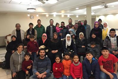 A's pitcher gets into Thanksgiving spirit by inviting 17 Syrian refugee families to dinner