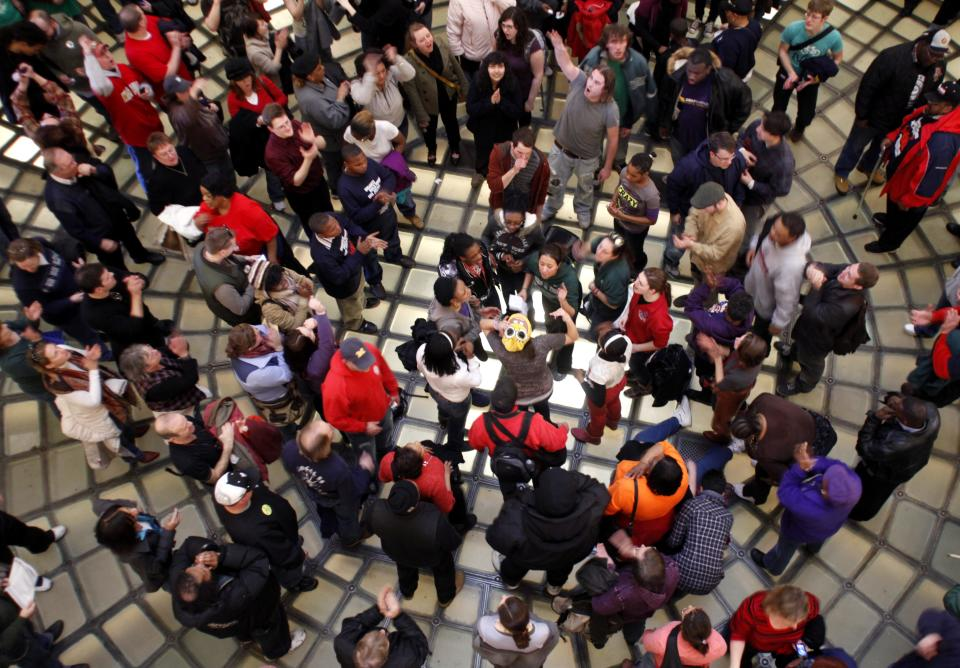 Protesters chant and sing in the Michigan Capitol Rotunda as they rally against Gov. Rick Snyder's proposals to tax pensions and give emergency financial managers sweeping new powers to void union contracts Wednesday, March 16, 2011, in Lansing, Mich. (AP Photo/Al Goldis)