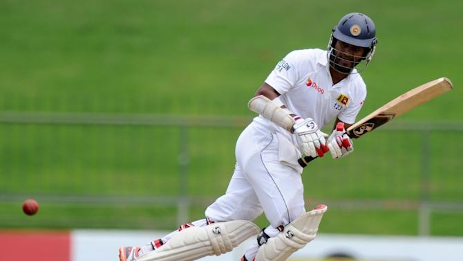 Sri Lanka's Dimuth Karunaratne plays a shot during the opening day of their third and final Test against Pakistan, at the Pallekele International Cricket Stadium, on July 3, 2015
