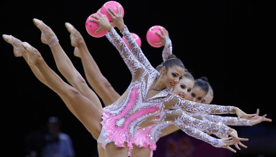 The team from Russia performs during the rhythmic gymnastics group all-around final at the 2012 Summer Olympics, Sunday, Aug. 12, 2012, in London. (AP Photo/Julie Jacobson)