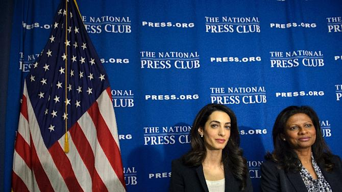 Lawyer Amal Clooney (L) and Laila Ali, wife of Mohamed Nasheed, sit together after a press conference at the National Press Club April 30, 2015 in Washington, DC, regarding attempts to get Ali's husband Nasheed released from prison