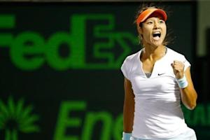 Mar 26, 2014; Miami, FL, USA; Li Na celebrates after her match against Caroline Wozniacki (not pictured) on day ten of the Sony Open at Crandon Tennis Center