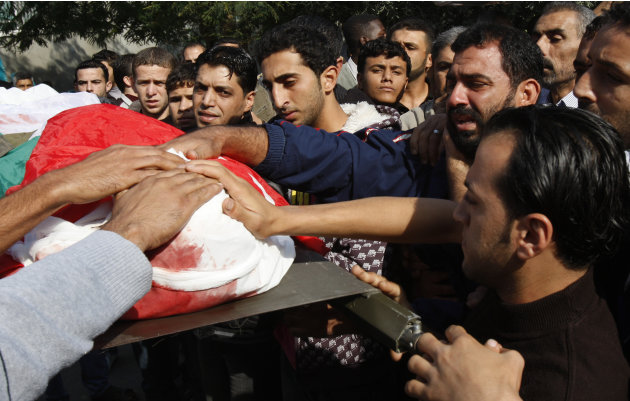 Palestinians carry the body of Osama Shehada, 17, during his funeral in the Nuseirat Refugee Camp, central Gaza Strip, Tuesday, Nov. 20, 2012. Shehada was killed in an Israeli air strike on Monday whi