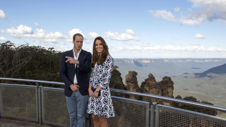 Britain's Prince William and his wife Catherine, the Duchess of Cambridge, stand at Echo Point Lookout at Katoomba in the Blue Mountains near Sydney