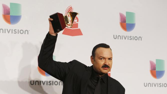 Pepe Aguilar poses with his award during the 15th Annual Latin Grammy Awards in Las Vegas