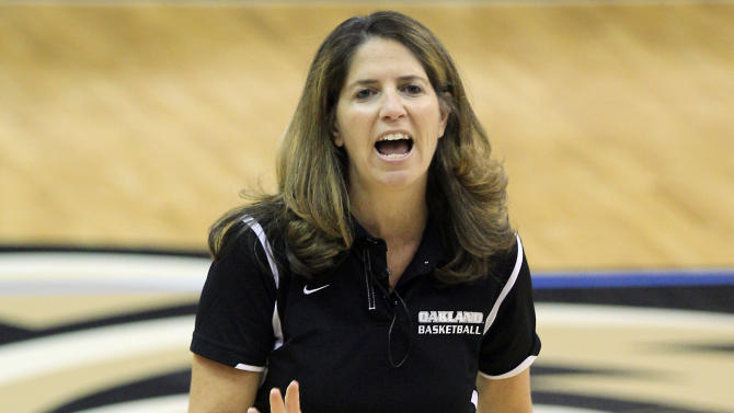 In a photo from Oct. 16, 2012, Oakland University women's basketball coach Beckie Francis looks over her team's practice in Rochester, Mich. Francis tells The Associated Press she was sexually assaulted by her dad, who is now deceased, from the age of 4 until she was in the seventh grade. The 47-year-old coach has decided to speak out against the problem in part because of the Jerry Sandusky scandal at Penn State. (AP Photo/Carlos Osorio)
