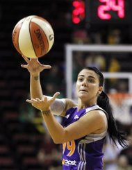 Phoenix Mercury's Samantha Prahalis passes in the first half of a WNBA basketball game against the Seattle Storm, Thursday, Aug. 16, 2012, in Seattle. (AP Photo/Elaine Thompson)
