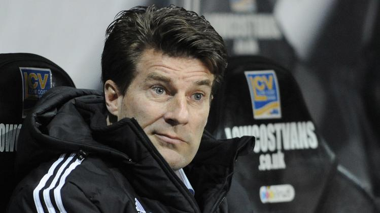 Swansea City's manager Michael Laudrup reacts during their English Premier League soccer match against Hull City at the Liberty Stadium in Swansea