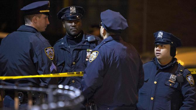 Police are pictured at the scene of a shooting where two New York Police officers were shot dead in Brooklyn, New York