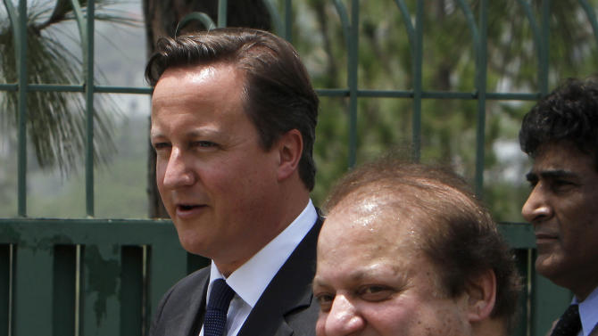 British Prime Minister David Cameron, left, with his Pakistani counterpart Nawaz Sharif leave after a joint press conference in Islamabad, Pakistan, Sunday, June 30, 2013. Cameron is in Islamabad on a tow-day visit to hold talks with Pakistani top leaders on bilateral interest, regional and international importance including the peace process in Afghanistan. (AP Photo/Anjum Naveed)