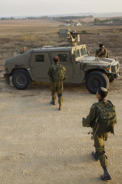 Israeli soldiers pause near an army base on the Israel Gaza border in southern Israel, Saturday, Aug. 20, 2011. Israel apologized to Egypt Saturday for the deaths of three Egyptian soldiers during a cross-border clash with Palestinian militants, hours after Cairo threatened to withdraw its ambassador to protest the killings. (AP Photo/Dan Balilty)