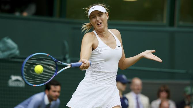 Maria Sharapova of Russia hits a shot during her match against Coco Vandeweghe of the U.S.A. at the Wimbledon Tennis Championships in London