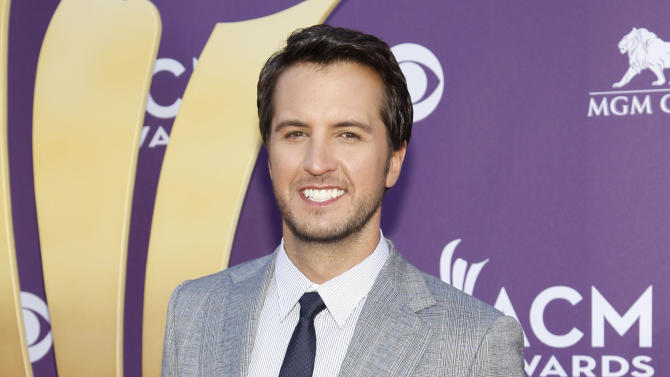 "FILE - This April 1, 2012 file photo shows country singer Luke Bryan at the 47th Annual Academy of Country Music Awards in Las Vegas. Bryan is joining Blake Shelton to co-host the 2013 Academy of Country Music Awards. The Academy announced Tuesday, Jan. 8, 2013, this year's show will be held April 7. Bryan replaces Reba McEntire, who served as host for more than a decade before stepping aside to concentrate on her new sit-com ""Malibu Country."" (AP Photo/Isaac Brekken, file)"