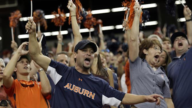 Ben Lawley of Birmingham, Ala., cheers for the Auburn Tigers during their game against Clemson in a NCAA college football game at the Georgia Dome in Atlanta Saturday, Sept. 1, 2012. (AP Photo/Dave Martin)