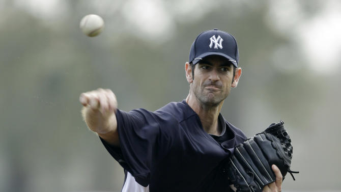 New York Yankees pitcher Mark Prior throws a pitch during a baseball spring training workout Tuesday, Feb. 22, 2011, at Steinbrenner Field in Tampa, Fla. (AP Photo/Charlie Neibergall)