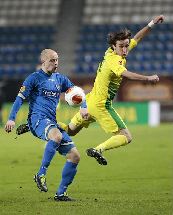 Tromso's Hans Norbye, left, and Anzhi's Alan Gatagov fight for the ball during the Europa League group K soccer match between Anzhi Makhachkala and Tromso IL at Saturn stadium in Ramenskoye, outside M