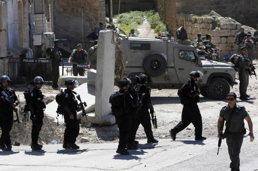 Israeli border policemen keep guard near a building, occupied by Jewish settlers, in the West Bank city of Hebron
