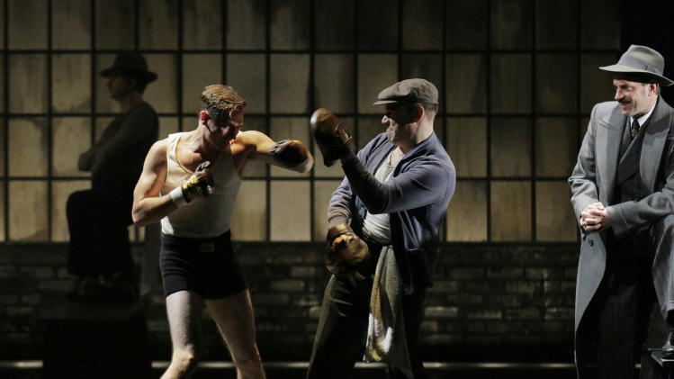 "This theater image released by Lincoln Center Theater shows, from left, Seth Numrich, Danny Burstein and Danny Mastrogiorgio in ""Golden Boy."" (AP Photo/Lincoln Center Theater, Paul Kolnik)"