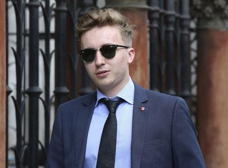 Anatoly Litvinenko, the son of murdered KGB agent Alexander Litvinenko, leaves the High Court in central London
